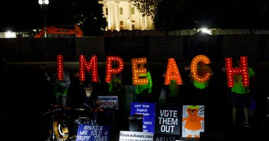 """Protesters with """"Kremlin Annex"""" call to impeach President Donald Trump in Lafayette Square Park in front of the White House in Washington, Tuesday, Sept. 24, 2019."""