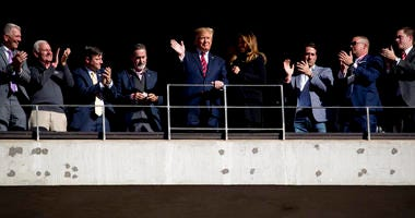 President Donald Trump and first lady Melania Trump wave during a NCAA college football game between LSU and Alabama at Bryant-Denny Stadium, in Tuscaloosa, Ala., Saturday, Nov. 9, 2019.