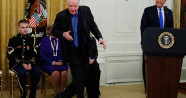 Jon Voight dances as President Donald Trump looks on during a National Medal of Arts and National Humanities Medal ceremony in the East Room of the White House, Thursday, Nov. 21, 2019, in Washington.