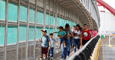 local residents with visas walk across the Puerta Mexico international bridge to enter the U.S.