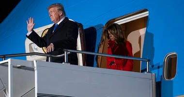 President Donald and first lady Melania Trump arrive at London Stansted Airport to attend the NATO summit, Monday, Dec. 2, 2019, in London.