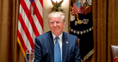 President Donald Trump smiles during a luncheon with members of the United Nations Security Council in the Cabinet Room at the White House in Washington, Thursday, Dec. 5, 2019.