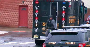 In this image taken from video, Hudson County Swat team officers arrive at the scene following reports of gunfire Tuesday, Dec. 10, 2019, in Jersey City, N.J.