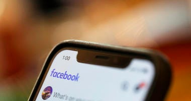 iPhone displays a Facebook page in New Orleans. A Ukrainian security researcher says a database with the names, phone numbers and unique user IDs of more than 267 million Facebook users was exposed on the open internet for at least 10 days this month.