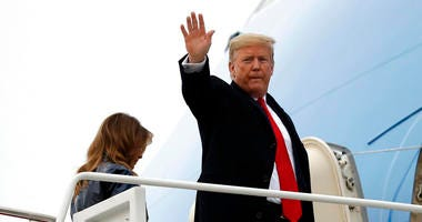 President Donald Trump boards Air Force One with first lady Melania Trump for a trip to New Orleans to attend the College Football Playoff National Championship game between LSU and Clemson, Monday, Jan. 13, 2020, at Andrews Air Force Base, Md.