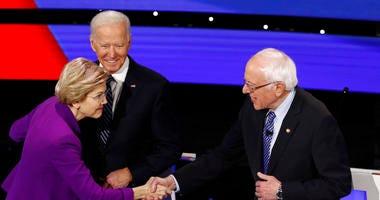 Senators Elizabeth Warren and Bernie Sanders greeting each other before the debate
