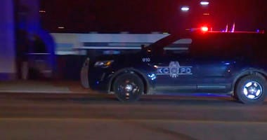 police vehicle passes with sirens near the scene of a shooting, Jan. 20, 2020, in Kansas City, Missouri. Police say at least two people are dead and upwards of a dozen people may have been injured in a shooting outside a bar.