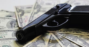 Pistol and money as sign of criminal activity