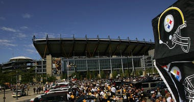 NFL fans tailgate before a game between the Houston Texans and the Pittsburgh Steelers on September 7, 2008 at Heinz Field in Pittsburgh, Pennsylvania.