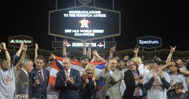 ; Los Angeles, CA, USA; Members of the Houston Astros are presented with the Commissioner's Trophy after defeating the Los Angeles Dodgers in game seven of the 2017 World Series at Dodger Stadium.