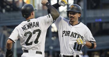 Pittsburgh Pirates shortstop Kevin Newman (27) greets center fielder Bryan Reynolds