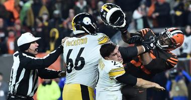 Cleveland Browns defensive end Myles Garrett (95) hits Pittsburgh Steelers quarterback Mason Rudolph