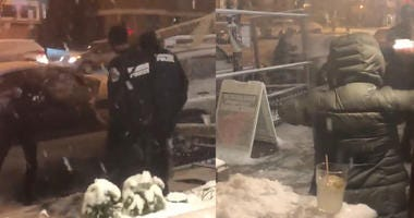 Watch Police Take on Bar Patrons in Hilarious Snowball Fight