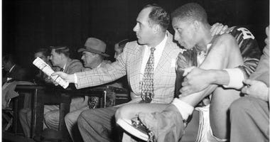 Duquesne great Chuck Cooper with Boston Celtics coach Red Auerbach
