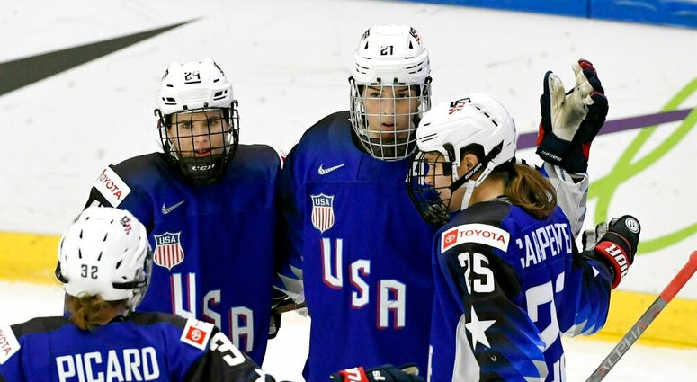 Michell Picard, Dani Cameranesi, Hilary Knight and Alex Carpenter of USA celebrate after scoring their team's first goal during the IIHF Women's Ice Hockey World Championships quarterfinal match between USA and Japan in Espoo, Finland, Thursday, April 11,