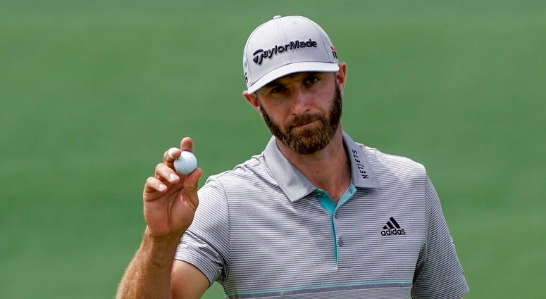 Dustin Johnson reacts on the second hole during the third round for the Masters golf tournament Saturday, April 13, 2019, in Augusta, Ga