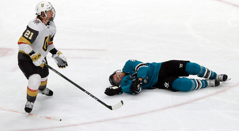 San Jose Sharks center Joe Pavelski, right, lies on the ice next to Vegas Golden Knights center Cody Eakin during the third period of Game 7 of an NHL hockey first-round playoff series in San Jose, Calif., Tuesday, April 23, 2019.