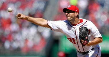 Washington Nationals starting pitcher Max Scherzer delivers a pitch during the first inning of a baseball game against the New York Mets, Thursday, March 28, 2019, in Washington.