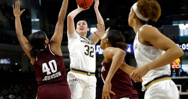 Notre Dame's Jessica Shepard (32) shoots over Texas A&M's Ciera Johnson (40) during the first half of a regional semifinal game in the NCAA women's college basketball tournament, Saturday, March 30, 2019, in Chicago.