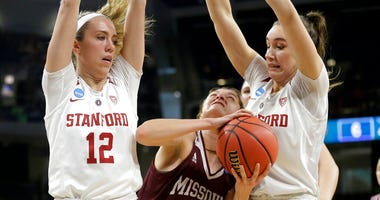 Missouri State's Alexa Willard (22) drives against Stanford's Lexie Hull (12) and Alanna Smith during the first half of a regional semifinal game in the NCAA women's college basketball tournament, Saturday, March 30, 2019, in Chicago.