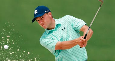 Jordan Spieth hits from the bunker to the second green during his practice round for the Masters at Augusta National Golf Club on Tuesday, April 9, 2019, in Augusta, Ga.