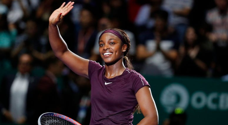 Sloane Stephens of the United States waves to the crowd after beating Naomi Osaka of Japan in their women's singles match at the WTA tennis tournament in