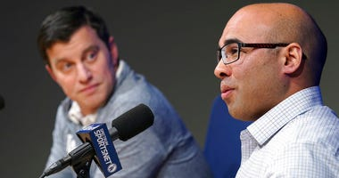 Los Angeles Dodger general manager Farhan Zaidi talks as President of Baseball Operations Andrew Friedman,