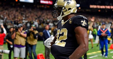 New Orleans Saints tight end Benjamin Watson celebrates his touchdown reception by putting the football under his jersey to pretend he is pregnant