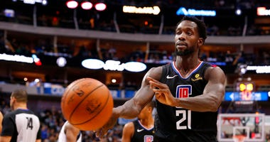 Los Angeles Clippers guard Patrick Beverley (21) throws a ball at a fan during the second half of an NBA basketball game against the Dallas Maverick