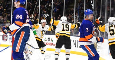 Pittsburgh Penguins center Derick Brassard (19) celebrates his goal with Penguins center Sidney Crosby