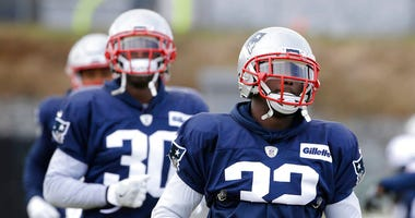 New England Patriots free safety Devin McCourty, front, and his brother cornerback Jason McCourty, left