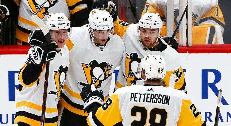 Pittsburgh Penguins defenseman Juuso Riikola (50) celebrates his goal against the Arizona Coyotes with center Derick Brassard (19), center Dominik Simon (12) and defenseman Marcus Pettersson (28) during the second period of an NHL hockey game Friday, Jan.
