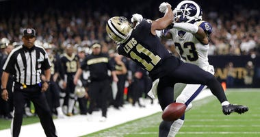 New Orleans Saints wide receiver Tommylee Lewis (11) works for a catch against Los Angeles Rams defensive back Nickell Robey-Coleman