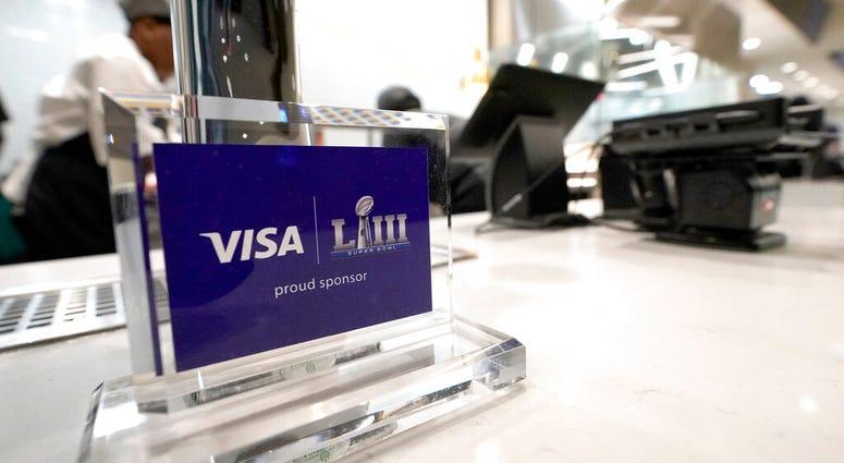 A Visa sponsorship sign sits on a restaurant counter at Mercedes-Benz Stadium