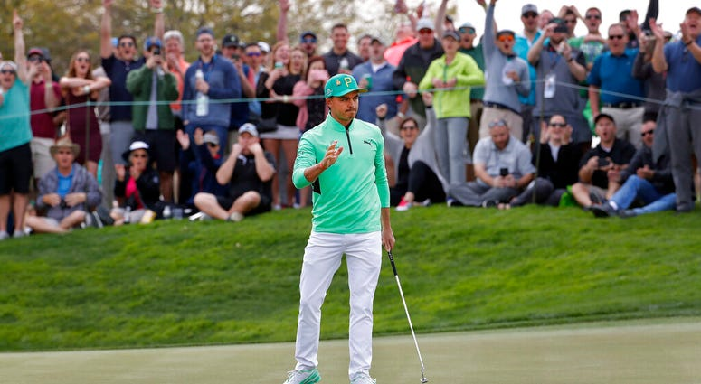 Rickie Fowler waves after making a birdie putt on the fifth green during the third round of the Phoenix Open PGA golf tournament, Saturday, Feb. 2, 2019