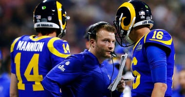 Los Angeles Rams head coach Sean McVay, center, speaks to Jared Goff (16) on the sideline during the second half of the NFL Super Bowl 53 football game against the New England Patriots, Sunday, Feb. 3, 2019, in Atlanta