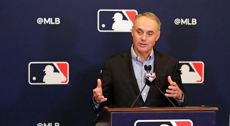 Rob Manfred, commissioner of Major League Baseball, speaks during a news conference at owners meetings Friday, Feb. 8, 2019, in Orlando, Fla.