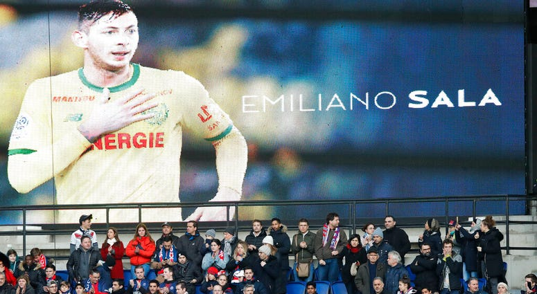 Tributes are paid to Emiliano Sala ahead of the French League One soccer match between Paris Saint-Germain and Bordeaux at the Parc des Princes stadium in Paris, Saturday, Feb. 9, 2019