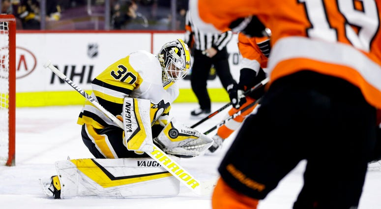 Pittsburgh Penguins' Matt Murray (30) blocks a shot during the second period of an NHL hockey game against the Philadelphia Flyers, Monday, Feb. 11, 2019, in Philadelphia