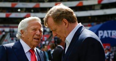 NFL Commissioner Roger Goodell, right, talks with New England Patriots owner Robert Kraft