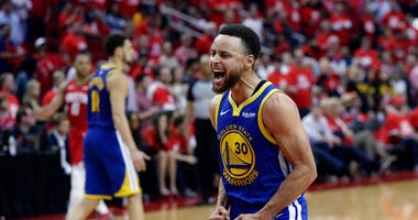 Golden State Warriors guard Stephen Curry (30) celebrates the team's win over the Houston Rockets in Game 6 of a second-round NBA basketball playoff series, Friday, May 10, 2019, in Houston. Golden State won 118-113, winning the series.