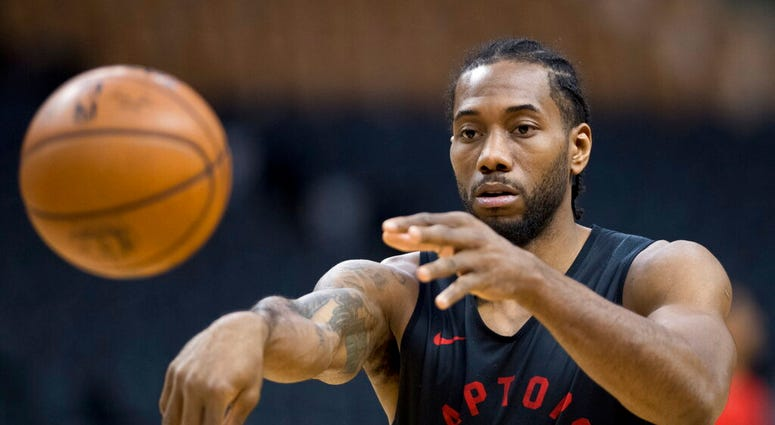 Toronto Raptors' Kawhi Leonard passes during practice for the NBA Finals in Toronto on Wednesday, May 29, 2019. Game 1 of the NBA Finals between the Raptors and Golden State Warriors is Thursday in Toronto