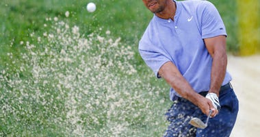Tiger Woods hits from the sand on the 13th hole during the first round of the Memorial golf tournament Thursday, May 30, 2019, in Dublin, Ohio.