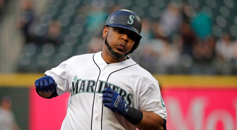 Seattle Mariners' Edwin Encarnacion rounds the bases after hitting a solo home run against the Houston Astros during the third inning of a baseball game, Monday, June 3, 2019, in Seattle.
