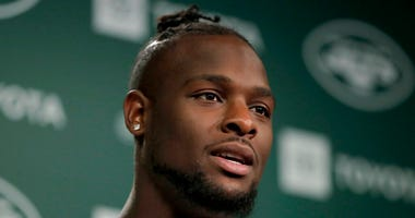 New York Jets running back Le'Veon Bell speaks to reporters at the team's NFL football training facility in Florham Park, N.J., Tuesday, June 4, 2019.