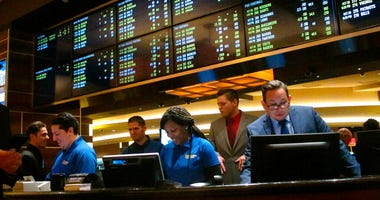 employees at the new sports book at the Tropicana casino in Atlantic City N.J., preparing to take bets moments before it opened. NBA and MLB executives staunchly believe their leagues deserve a cut of sports betting revenue. But their problem has been con
