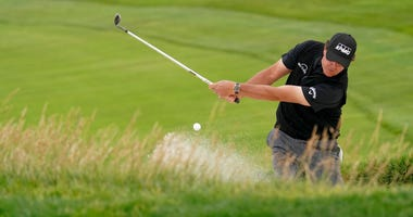 Phil Mickelson hits out of the bunker on the 10th hole during the first round of the U.S. Open Championship golf tournament Thursday, June 13, 2019, in Pebble Beach, Calif.