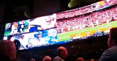 customers watch sports on a giant screen at the sports book of the Ocean Resort Casino in Atlantic City