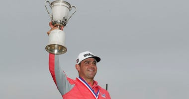 Gary Woodland celebrates with the trophy after winning the U.S. Open Championship golf tournament Sunday, June 16, 2019, in Pebble Beach, Calif.
