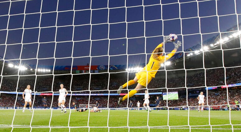 United States goalkeeper Alyssa Naeher is airborne as she makes a save during the Women's World Cup quarterfinal soccer match between France and the United States at Parc des Princes in Paris, France, Friday, June 28, 2019.